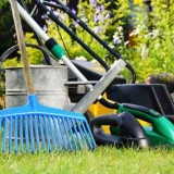 Watering can and tools in the garden